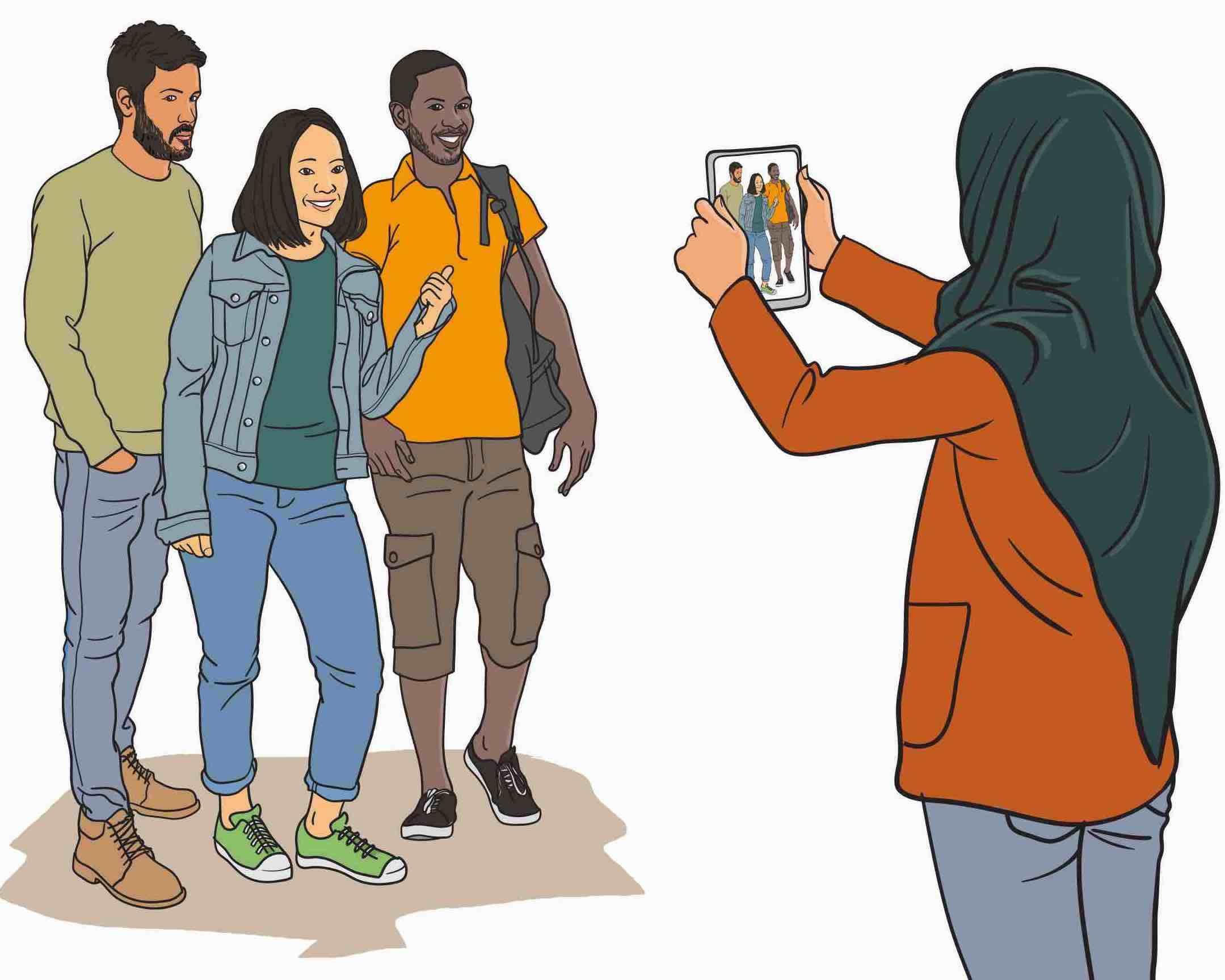 Junge Frau filmt Gruppe mit dem Tablet